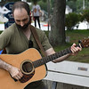 JIM VAIKNORAS/Staff photo Ed Novak of Georgetown,plays guitar with Two Weeks From Everywhere at the board walk in Newburyport.
