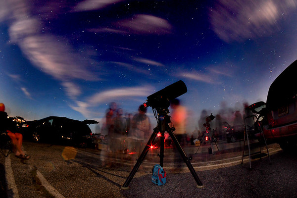 JIM VAIKNORAS/Staff photo The stars and planets in the western sky shine as people take in views of Jupiter through a 10 inch reflector telescope belonging to club president Mike Deneen at North Shore Amateur Astronomy Club (NSAAC) star party at Salisbury Beach Reservation.