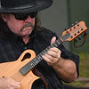 JIM VAIKNORAS/Staff photo Mark Aleo of Lowell,plays mandolin with Two Weeks From Everywhere at the board walk in Newburyport.