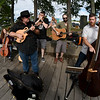 JIM VAIKNORAS/Staff photo Two Weeks From Everywhere perform at the boardwalk in Newburyport. From Left  Lauren Parks, Boston, on cello,  Mark Aleo, Lowell, on mandolin,  Robert Stalvey, North Andover, on harmonica Ed Novak, Georgetown,on guitar and Jay LaBelle, Merrimac, on  bass.