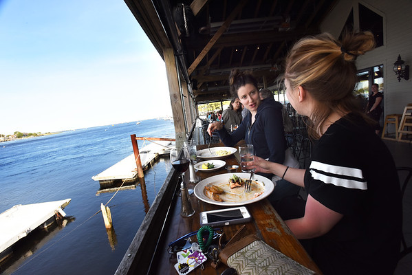 BRYAN EATON/Staff photo. Ashley Tucker, left, of East Boston and Katie Eisnor of Stoneham finish dinner at Black Cow.