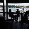 BRYAN EATON/Staff photo. The Black Cow deck affords great views of the Merrimack River and the Gillis Bridge.