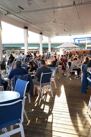 BRYAN EATON/Staff photo. Patrons of The Deck in Salisbury get a great view of the Newburyport skyline across the Merrimack River.
