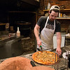 JIM VAIKNORAS/Staff photo Cody Walsh slices a pizza at Flatbreads in Amesbury.