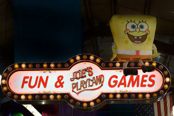 JIM VAIKNORAS/Staff photo A large stuffed Sponge Bob sits on a sign welcoming visitors to Joe's Playland.