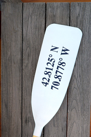 JIM VAIKNORAS/Staff photo Oar with the Latitude and Longitude of Newburyport on it at Sage Design in Newburyport.
