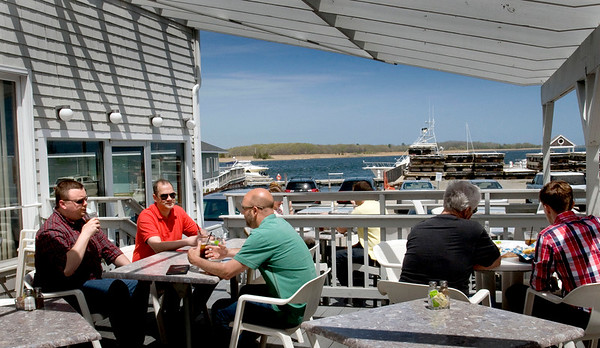 BRYAN EATON/ File photo. In nice weather diners can enjoy lunch or dinner on the Starboard Galley's deck with a view of the Merrimack River.