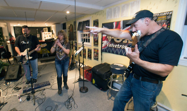JIM VAIKNORAS/Staff photo The Joppa Flatts founder Chris Santarelli ques his band mates Craig MacDonald and Ellen Katz during a rehearsel in Rowley.