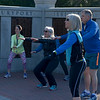 JIM VAIKNORAS/Staff photo Nancy McCarthy leads an early morning Couch to 5K workout at Atkinson Common in Newburyport.