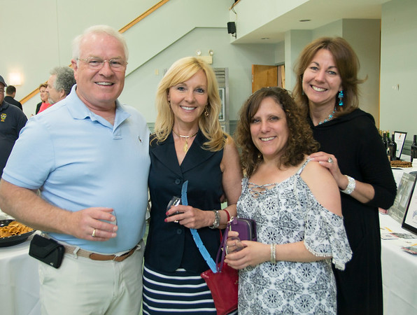 JIM VAIKNORAS/Staff photo Gig Michaud, Caryn Wilson, Charlene Smith and Gia Page at Toast to Our Troops Wine & Food Tasting at Nicholson Hall in Newburyport.