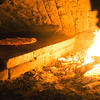 JIM VAIKNORAS/Staff photo A pizza cooks in the woodfired oven at Flatbreads in Amesbury.