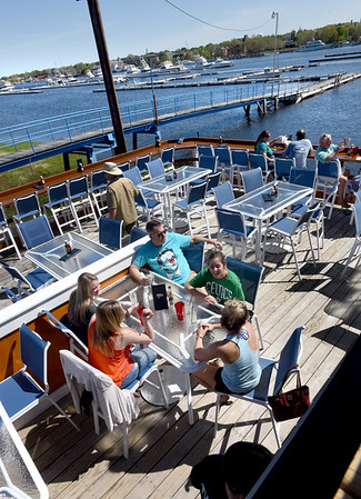 BRYAN EATON/Staff photo. Friends meet on the opening day of The Deck in Salisbury, clockwise from lower, left, Sommer Spillane, Byfield; Jessica Grasso, Amesbury; Joey Paquette, Amesbury; Amanda Atchley, Salisbury and Carly LeSage of Salisbury.