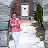 JIM VAIKNORAS/Staff photo Elena Bachrach, Executive Director of  the Newburyport Art Association in the Sculpture Garden.