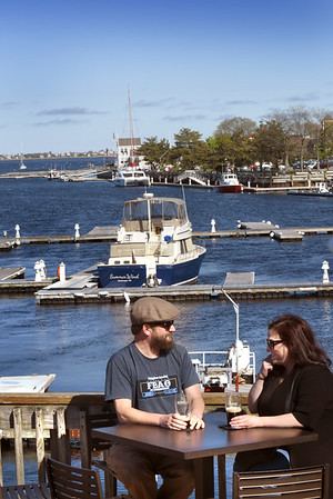 BRYAN EATON/Staff photo. Cyrus Rogers and April Langis of South Hampton, N.H. on the upper deck at Michael's Harborside.