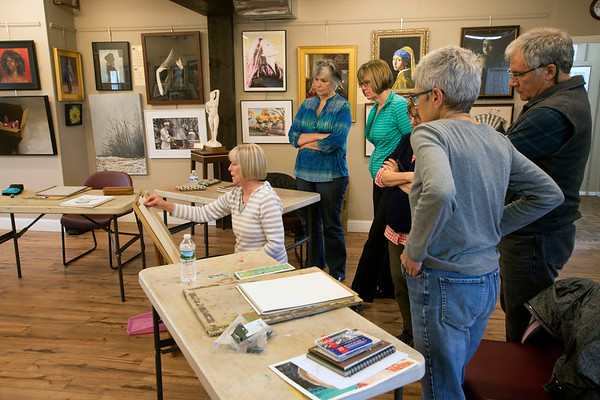 JIM VAIKNORAS/Staff photo Artist Sue Spellman , seated, teaches a drawing class at the Newburyport Art Association, she is surrounded by students ,Paula Mollov, Linda Fleck, Mary Beth Stevens, Jay McGovern, and Linda Dolmarch.