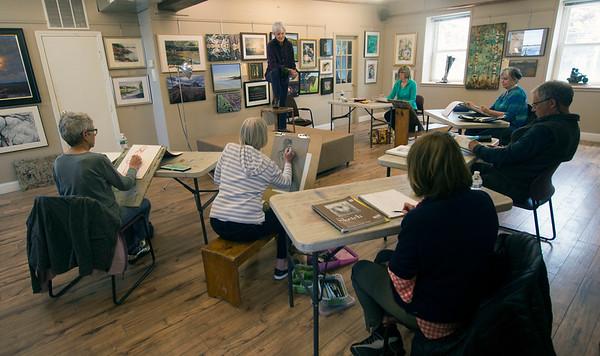 JIM VAIKNORAS/Staff  photo Model Mara Kirby poses during artist Sue Spellman  drawing class at the Newburyport Art Association.