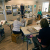 JIM VAIKNORAS/Staff  photo Model Mara Kirby poses during artist Sue Spellman  drawing class at the Newburyport Art Association.