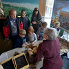 JIM VAIKNORAS/Staff photo Volunteer Mary Jacobson talks about pelts and skulls at the Parker River Earth Day Festival.
