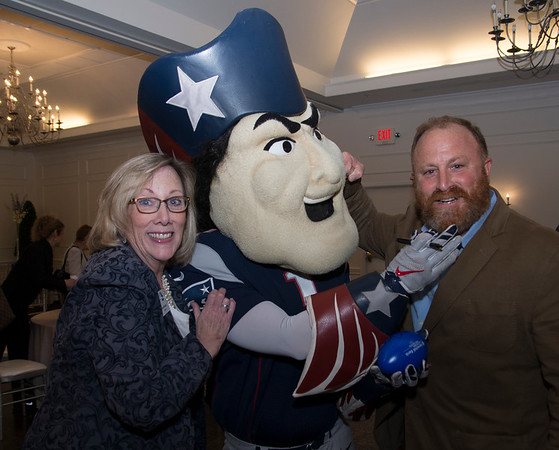 JIM VAIKNORAS/Staff photo Chamber president Anne Ormond and David Strand of Strand Marketing clown around with Pete Patriot  at the Greater Newburyport Chmber of Commerce meeting at the Black Swam in Georgetown.