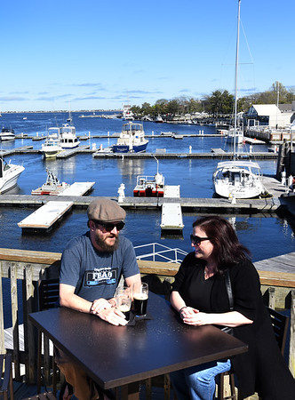 BRYAN EATON/Staff photo. Cyrus Rogers and April Langis of South Hampton, N.H. on the upper deck of Michael's Harborside.