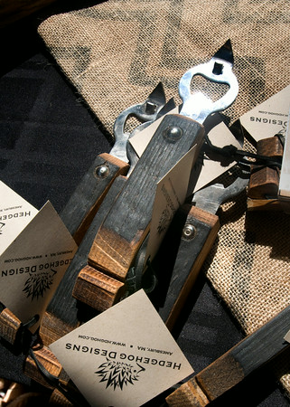 Bottle openers made with charred oak barrel pieces that was used for bourbon.