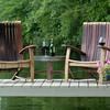 Adirondack chairs with grooves cut into the arms to hold wine glasses.