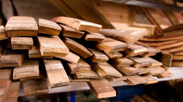 Staves lined up on shelves to be used in whatever design Chris comes up with.