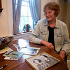 JIM VAIKNORAS/Staff photo Karleen Johnson looks over old photos of her parents.