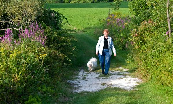 JIM VAIKNORAS/Staff photo Karleen Johnson and her dog Kuma walk through the French Pettengill Perserve.
