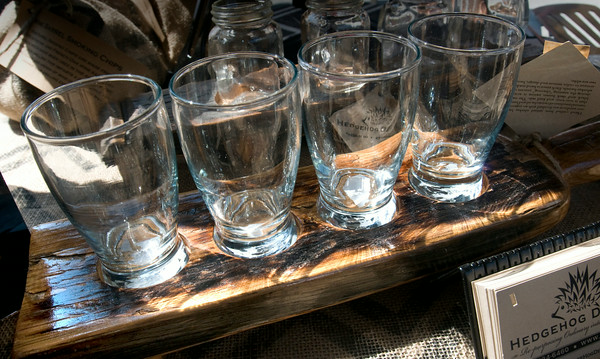 A flight holds four glasses to be used to share bourbon, scotch or even for beer samples.