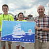 JIM VAIKNORAS/Staff photo  Alex Bradley, Mayor Donna Holaday and Sean Welsh with the new Newburyport Flag.