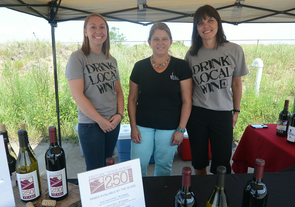 JIM VAIKNORAS/Staff photo Angela Lattime, Donna Martin, and Michele Norton of Mill River Winery at the Newburyport 250th Clam Bake.