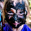 Red Fox Catherine Carroll , 8, covered her face with mud at Four Rock