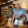 JIM VAIKNORAS/Staff photo  Rick Hayes at Lilyput get a hand from PJ Halloran as he makes tea during the Newburyport Food Tour.