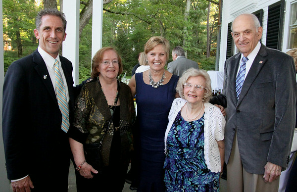 Photo by Frank J. Leone, Jr.<br /> Enjoying the evening, from left, Lane Glenn of Amesbury, NECC president, Regina Correia-Branco, Co-host Ann<br /> Lagasse, Helen and Byron Matthews, former board of trustees chairman, all of Newburyport,<br /> at the Women of Northern Essex Community College 18th Annual Fundraising Event, Saturday, home<br /> of Ann and Charles Lagasse, Newburyport.<br /> 6-14-14