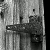 JIM VAIKNORAS/Staff photo A rusty hinge on an old door on one of the out buildings at the French-Pettengill Preserve in Salisbury.