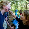 Crew member Paulie Corbett get her face painted with mud by Reilly Andrews  at Four Rock