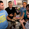 JIM VAIKNORAS/Staff photo PJ Halloran hands cupcake to Rick Yorgey,Stephen Winslow, Lynnette Yorgey Winslow,and  Elissa Yorgey at Eat Cake on Inn Street during his Newburyport Food Tour.