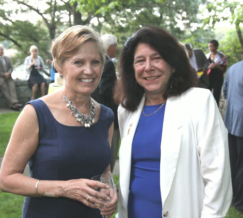 Photo by Frank J. Leone, Jr.<br /> Catching up, at left, co-host Ann Lagasse and Newburyport Mayor Donna Holaday, both of Newburyport,<br /> at the Women of Northern Essex Community College 18th Annual Fundraising Event, Saturday, home<br /> of Ann and Charles Lagasse, Newburyport.<br /> 6-14-14