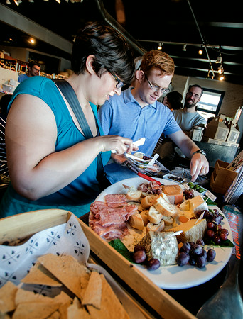 JIM VAIKNORAS/Staff photo Stephen Winslow and Lynnette Yorgey Winslow sample the food at Joppa Fine Foods during his Newburyport Food Tour.