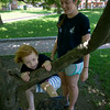 Sarah Sullivan climbs a tree with some help from crew member Kaeleigh Belanger