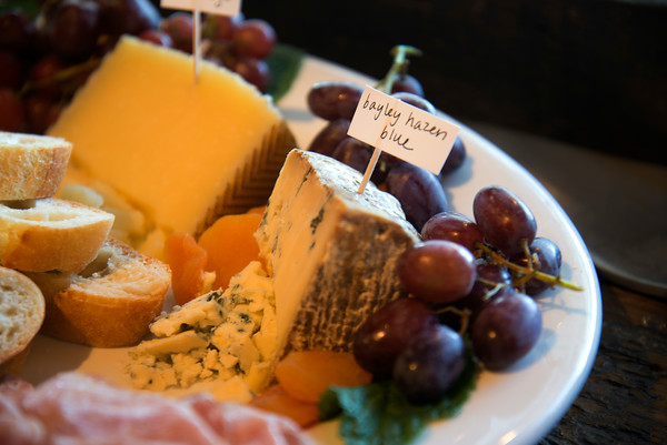 JIM VAIKNORAS/Staff photo  A cheese plate with grapes , olives, dried meats, and bread at Joppa Fine Food.