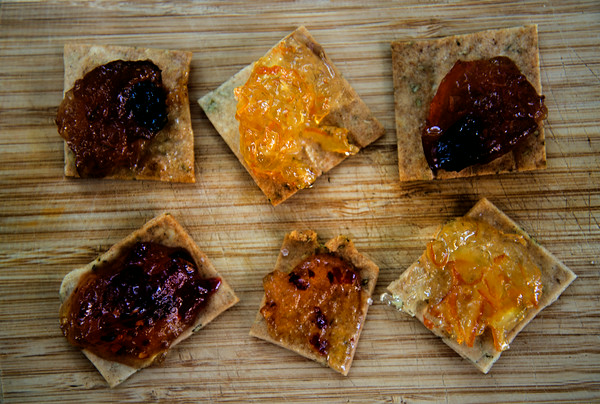 JIM VAIKNORAS/Staff photo Fig Chutney, Orange Marmalaide, and Hot Pepper Jelly on sea salt crackers