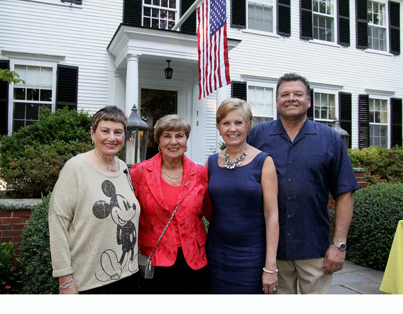 Photo by Frank J. Leone, Jr.<br /> Event organizers, at left,  Jean Poth, of Grovelend, NECC vice-president of institutional advancement, Gerri Murphy of<br /> North Andover, Women of NECC president, co-hosts of event, Ann and Charles Lagasse of Newburyport, <br /> at the Women of Northern Essex Community College 18th Annual Fundraising Event, Saturday, home<br /> of Ann and Charles Lagasse, Newburyport.
