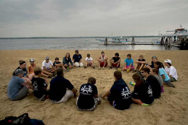 JIM VAIKNORAS/Staff photo..Kids talk in a circle planning how to load the Capt George off Plum Island Point for their trip to the Isle of Shoals.