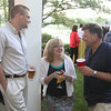 Photo by Frank J. Leone, Jr.<br /> Sharing a moment, from left,  Charlie Lagasse of Newburyport, Susan Harrington of Haverhill and co-host, Charles<br /> Lagasse of Newburyport, <br /> at the Women of Northern Essex Community College 18th Annual Fundraising Event, Saturday, home<br /> of Ann and Charles Lagasse, Newburyport.<br /> 6-14-14
