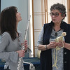 JIM VAIKNORAS Dr. Lea Pearson of Music Minus Pain works with flutist Corinne Cothern  during a workshop at PITA Hall.