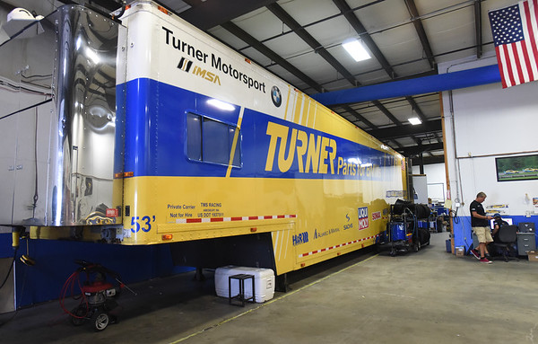 BRYAN EATON/Staff Photo. The large trailers that make the race circuit travel with the cars in a top compartment and the support equipment below.