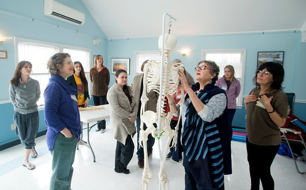 JIM VAIKNORAS Dr. Lea Pearson of Music Minus Pain uses a skeleton to demonstrate  positioning during a workshop at PITA Hall.