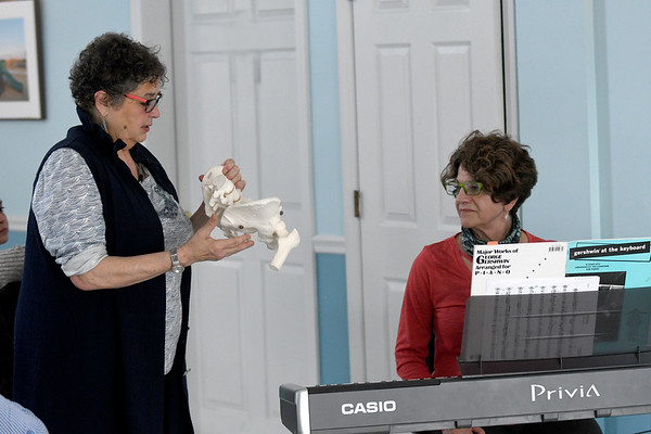 JIM VAIKNORAS Dr. Lea Pearson of Music Minus Pain works with Christine Pulucci during a workshop at PITA Hall.